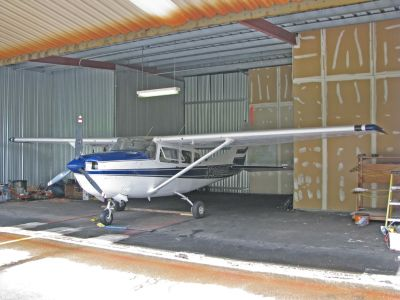 N756PY inside the Pine Hill hangar at BED