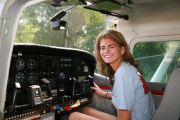 Girl in Cessna 182 cockpit